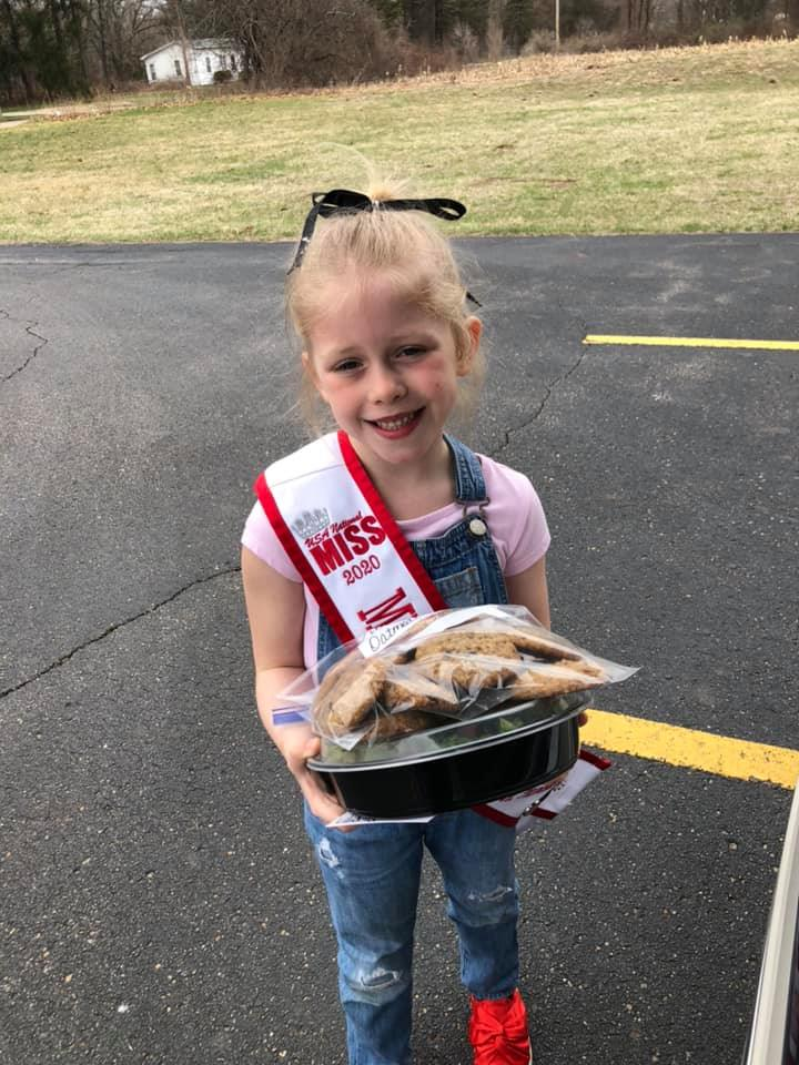 Lily delivering dinner to first responders.